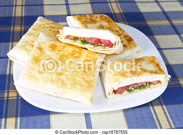 Pita Bread with Cheese, Tomato and Herbs - csp18787555