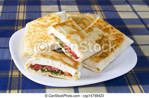 Pita bread with cheese, tomato and herbs - csp14748423