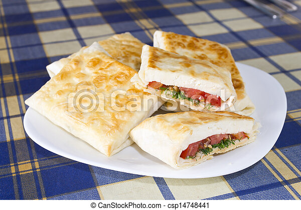 Pita bread with cheese, tomato and herbs - csp14748441
