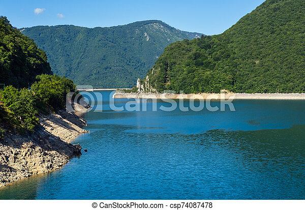 Piva Lake (Pivsko Jezero) view in Montenegro. - csp74087478