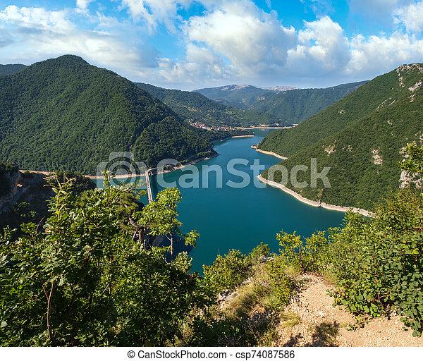 Piva Lake (Pivsko Jezero) view in Montenegro. - csp74087586