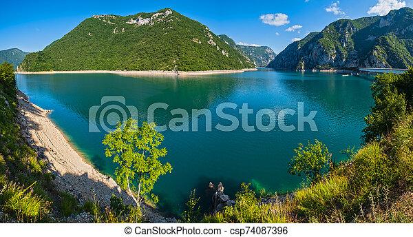 Piva Lake (Pivsko Jezero) view in Montenegro. - csp74087396