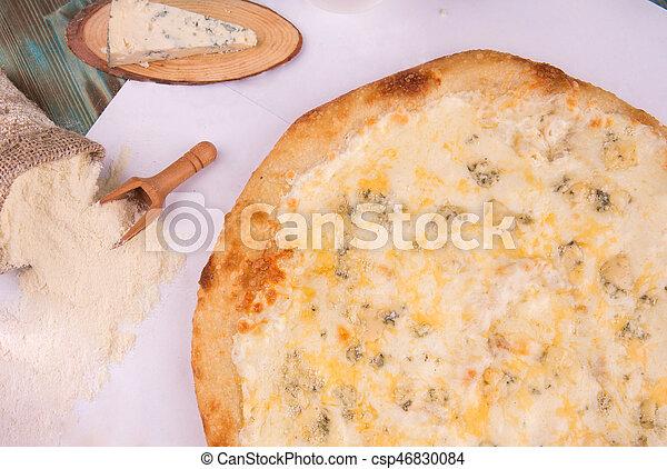 Pizza 4 cheeses with cheese a mozzarella, Gouda cheese, crude Dorblu and cheese sauce - csp46830084