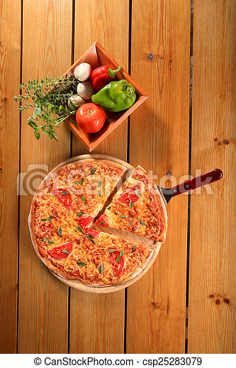 pizza on a wooden plate - csp25283079