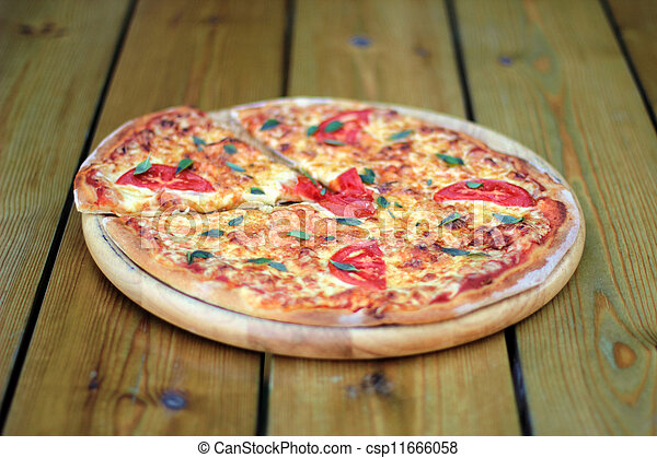pizza on a wooden plate - csp11666058 & Pizza on a wooden plate. Fresh pizza margarita on a wooden... stock ...