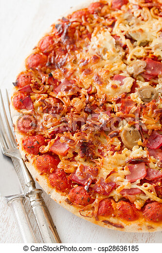 pizza on white wooden background - csp28636185