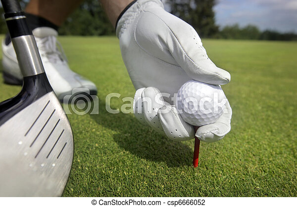 Placing golf ball on a tee  - csp6666052