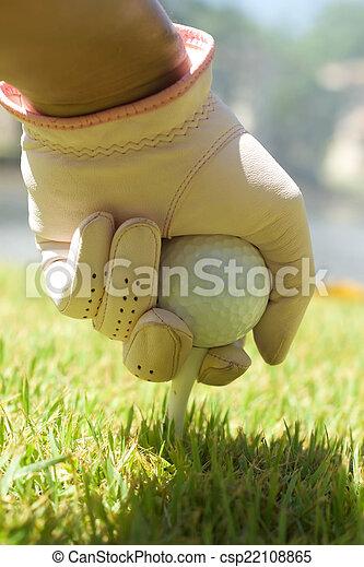 Placing golf ball - csp22108865
