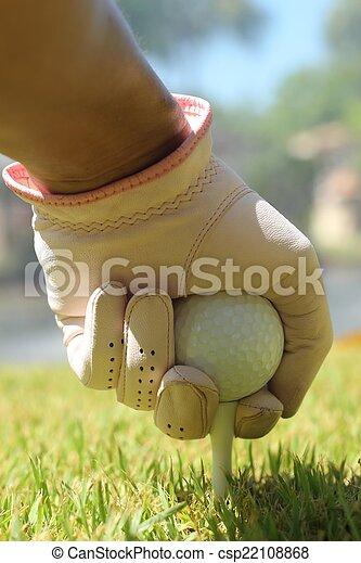 Placing golf ball - csp22108868