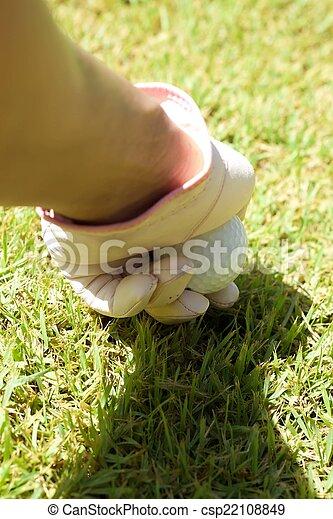 Placing golf ball - csp22108849