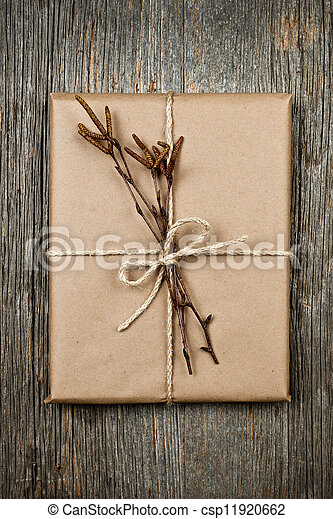 Plain gift with natural decorations - csp11920662