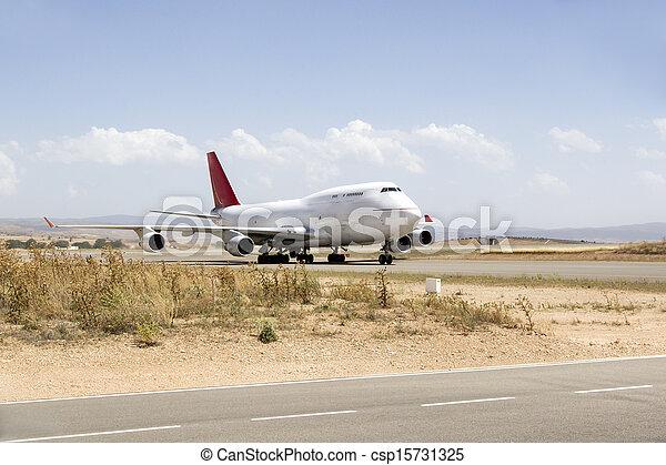 plane boeing 747 in runway an airport - csp15731325