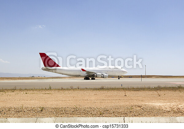 plane boeing 747 in runway an airport - csp15731333