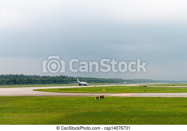 Plane speed up on airport runway - csp14076731