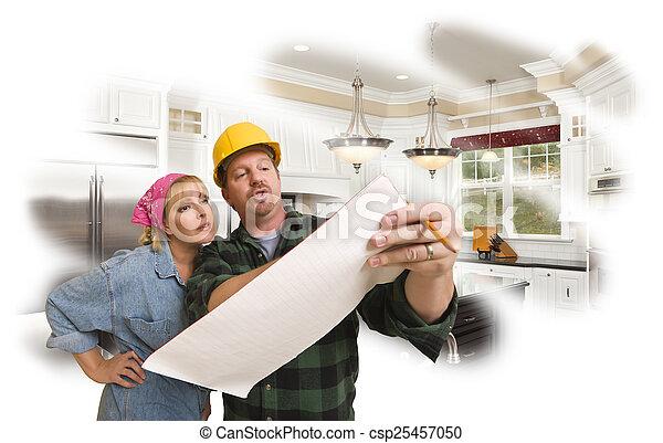Contratista hablando de planes con mujer, foto de cocina detrás - csp25457050