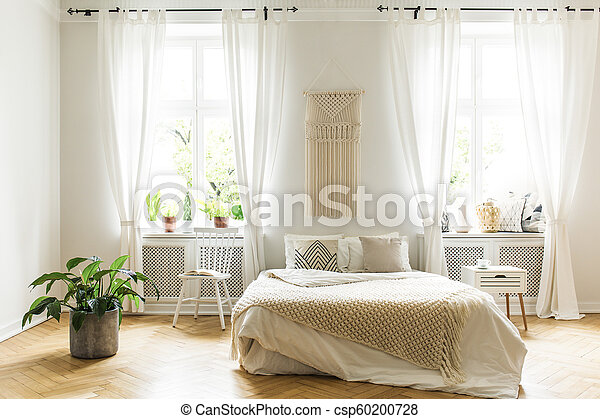 Miraculous Plant And White Chair Next To Bed With Blanket In Bright Bedroom Interior With Windows Real Photo Spiritservingveterans Wood Chair Design Ideas Spiritservingveteransorg