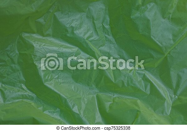 plastic background of a piece of crumpled cellophane - csp75325338