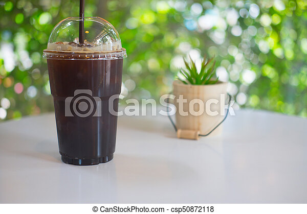 Plastic cup of iced black coffee americano - csp50872118