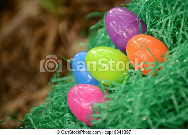Plastic Easter Eggs In Fake Grass