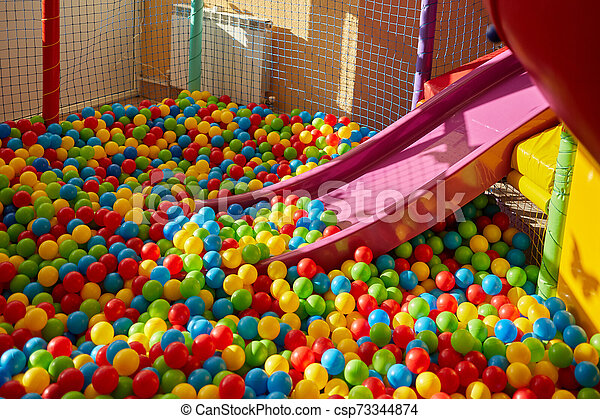 Plastic Slide With Colourful Balls For The Kid's Playground - csp73344874
