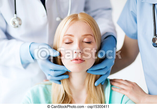 plastic surgeon or doctor with patient - csp15300411