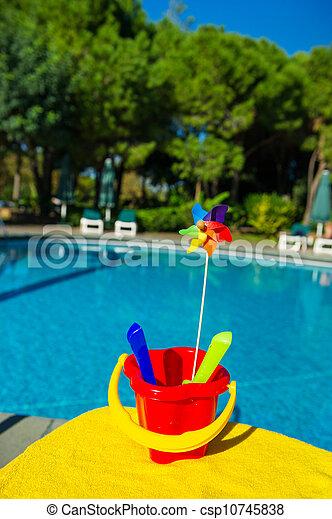 Plastic toys near swimming pool - csp10745838