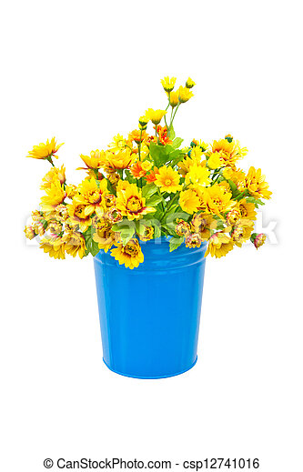 Plastic yellow flowers with metal blue vase. - csp12741016