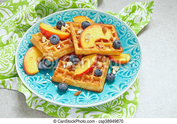 Plate of belgian waffles with fresh berries - csp38949870