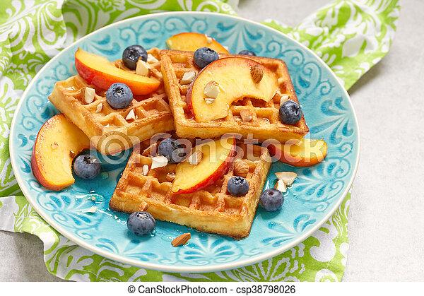 Plate of belgian waffles with fresh berries - csp38798026