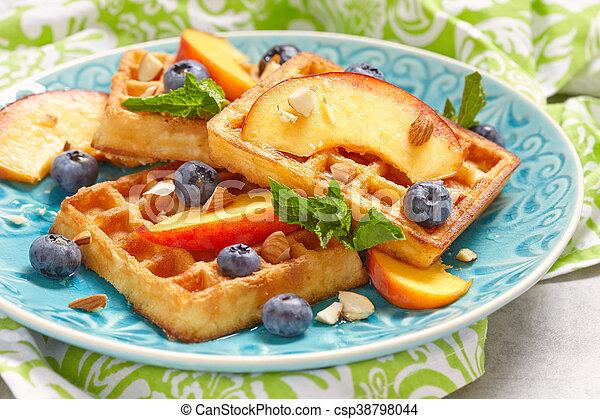 Plate of belgian waffles with fresh berries - csp38798044