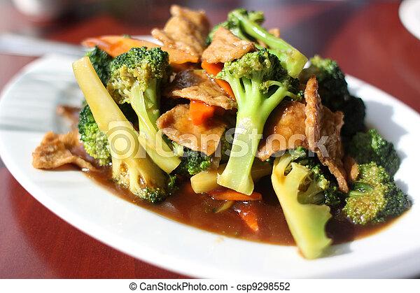 Plate of broccoli with vegan seitan - csp9298552
