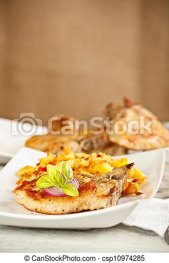 Plate of chop pork - csp10974285