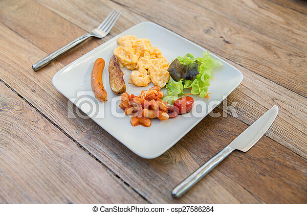 plate of different food on table - csp27586284