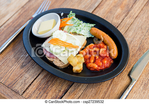 plate of different food on table - csp27239532