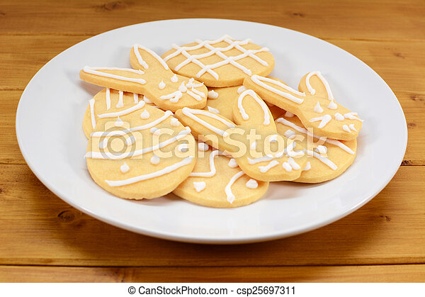 Plate of Easter cookies - eggs and bunnies - csp25697311