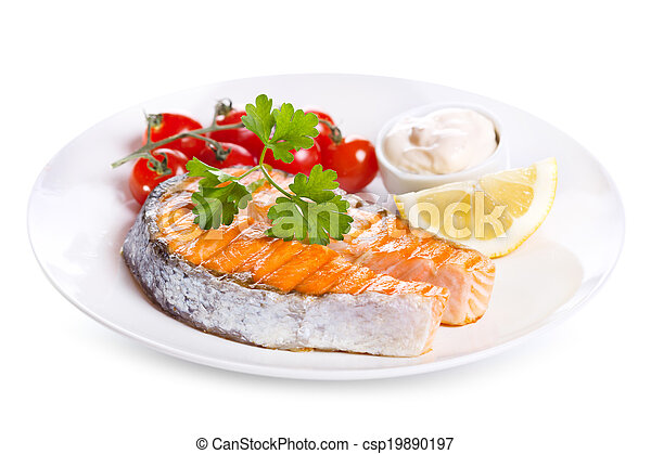 plate of grilled salmon steak with vegetables - csp19890197