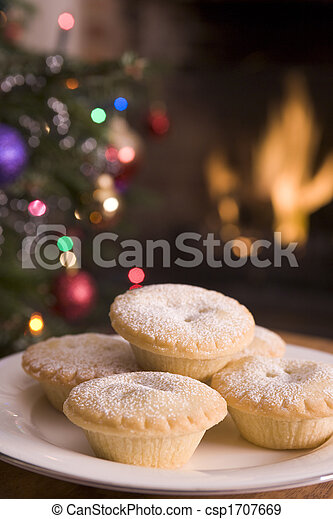 Plate of Mince Pies Log Fire and Christmas Tree - csp1707669