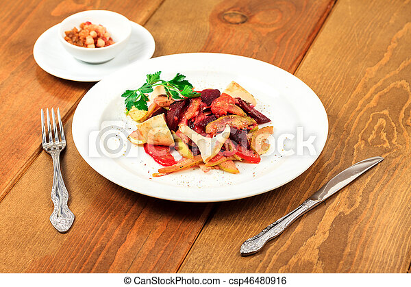 Plate of salad on a wooden table - csp46480916