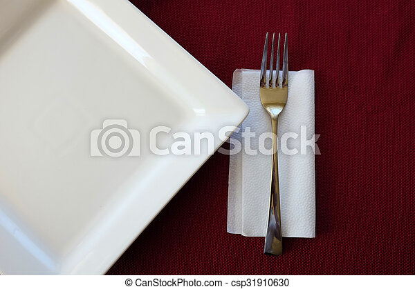 Plate red table cloth fork napkin setting. Fork silverware with ...