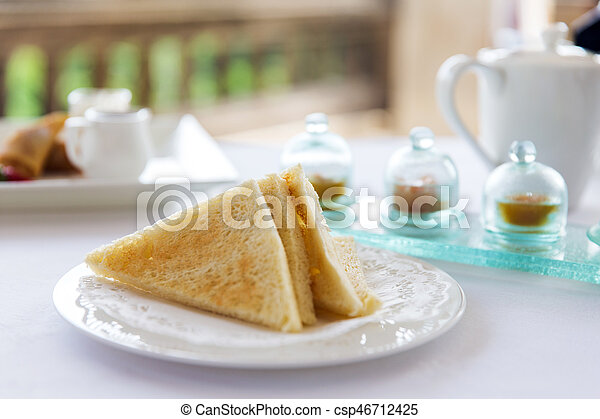 plate with toast bread on table - csp46712425