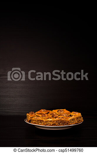 Plate with Turkish baklava honey on a black background - csp51499760