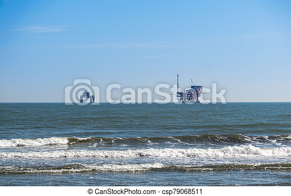 platform in the Sea . oil platform from the beach - csp79068511