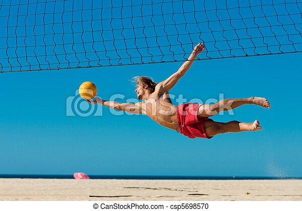 Voleibol de playa, hombre saltando - csp5698570