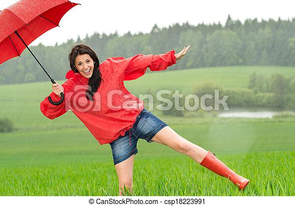 Playful happy girl in the rain - csp18223991