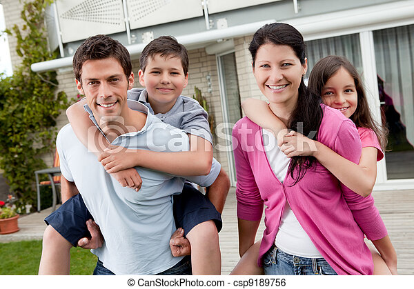 Playful young family enjoying together - csp9189756