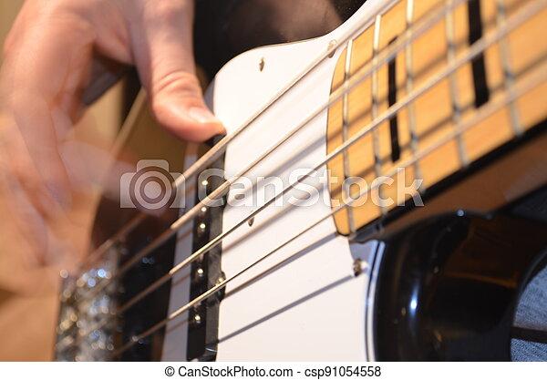 Playing Bass - csp91054558