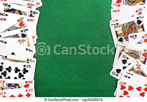 Playing cards isolated on green background - csp32428419