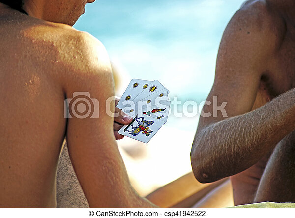 Playing cards on the beach - csp41942522