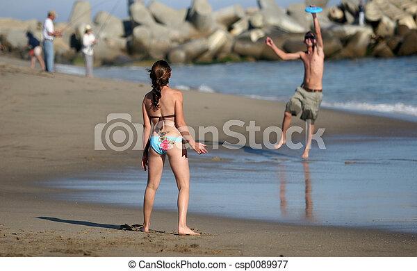 Playing frisbee - csp0089977