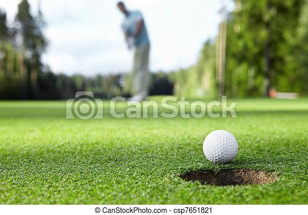Playing golf - csp7651821